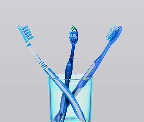 bigstock Toothbrush in glass and chewin 38661922